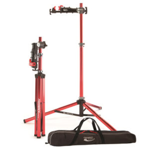 Two repair stands and tote bag - one stand fully set up ready for use and the other folded, ready for storage or travel