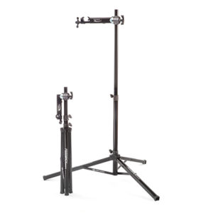 Two repair stands - one fully set up ready for use and the other folded, ready for storage or travel